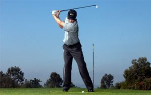 Front knee drill with golf alignment sticks - AEC Info